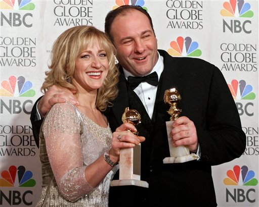 """FILE - This Jan. 23, 2000 file photo shows actors Edie Falco, left, and James Gandolfini with their awards for best performance by an actress and actor in a dramatic televison series for """"The Sopranos,"""" during the 57th Golden Globe Awards in Beverly Hills, Calif. HBO and the managers for Gandolfini say the actor died Wednesday, June 19, 2013, in Italy. He was 51. (AP Photo/Kevork Djansezian, file)"""
