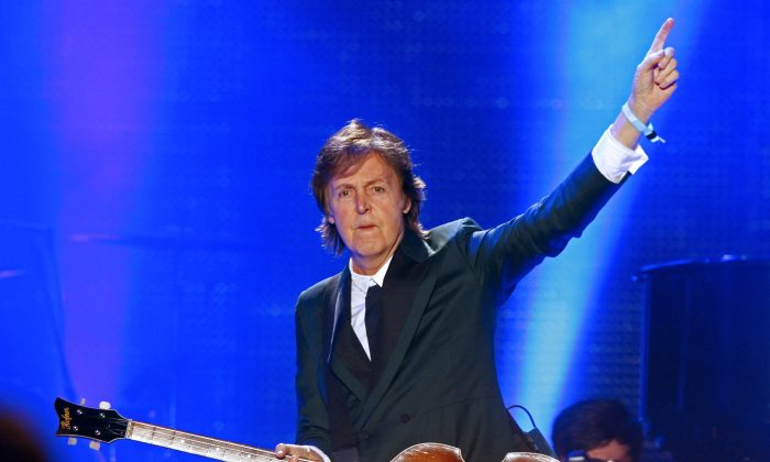 Paul McCartney, left-handed, performs on Day 2 of the 2013 Bonnaroo Music and Arts Festival on Friday, June 14, 2013 in Manchester, Tenn. (Photo by Wade Payne/Invision/AP)