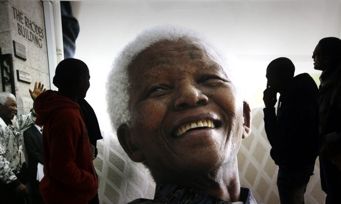 Giant photographs of Nelson Mandela displayed at the Nelson Mandela Legacy Exhibition at the Civic Centre in Cape Town, South Africa, Thursday, June 27, 2013. (AP Photo)