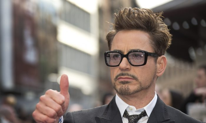 """Robert Downey Jr at the UK premiere of """"Iron Man 3,"""" in central London on April 18, 2013. ( Joel Ryan/Invision/AP)"""