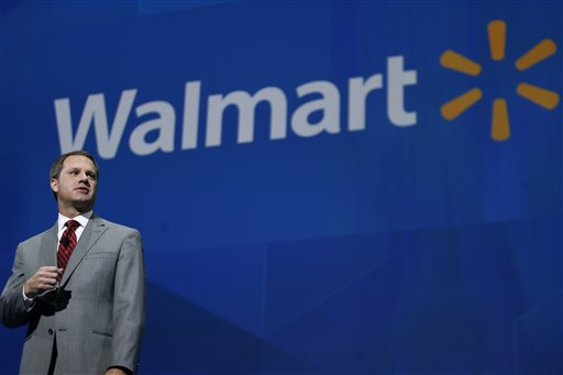 President and CEO, Walmart International Doug McMillan addresses the crowd on Wal-Mart 's 2012 worldwide sales during the Walmart shareholders meeting in Fayetteville, Ark., Friday, June 7, 2013. The company recently launched an all-out offensive to capture Dollar Store customers. (AP Photo/Gareth Patterson)