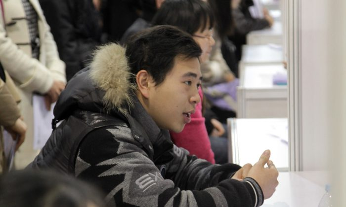 Hundreds of students apply for jobs during a job fair for graduates at Shanghai International Exhibition Center on Jan. 10, 2012 in Shanghai, China. Millions of young college graduates are searching for work in Chinese cities. (ChinaFotoPress/Getty Images)