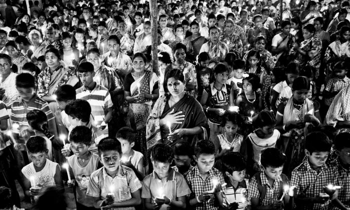 Villagers near the Kudankulam nuclear power plant site in Tamil Nadu State, India, observe a candlelight vigil to pay homage to Hiroshima victims on Hiroshima Day on Aug. 6, 2012. For more than a year, protests have surrounded the Kudankulam site. (Amrithraj Stephen)