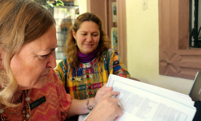 Mary Lou Ridinger (L) and Raquel Perez, go over evidence they have collected about jade smuggling in Guatemala. (Courtesy of Myriam Moran)