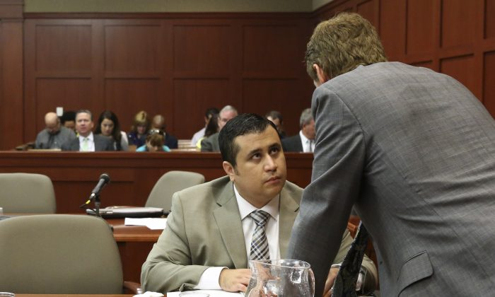 George Zimmerman, left, talks with his defense attorney Mark O'Mara during his trial in Seminole circuit court in Sanford, Fla. Tuesday, June 25, 2013. Zimmerman has been charged with second-degree murder for the 2012 shooting death of Trayvon Martin. (Gary W. Green/Orlando Sentinel)