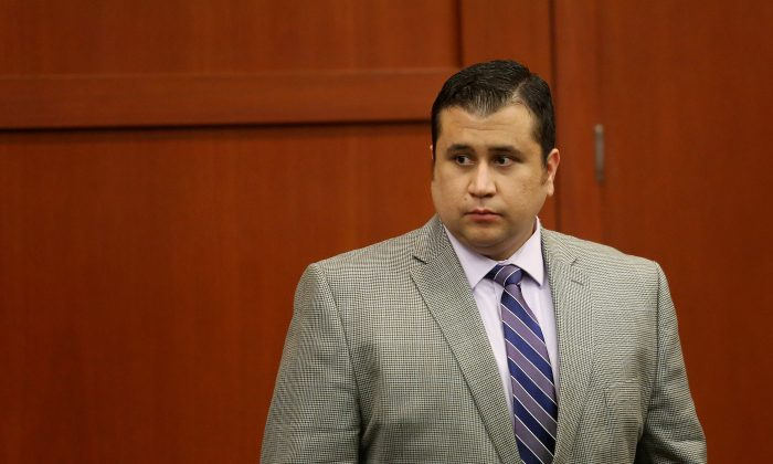 George Zimmerman leaves the courtroom court for the day in his trial in Seminole circuit court in Sanford, Fla. on Thursday, June 27, 2013. The trial continues on June 28. (AP Photo/Orlando Sentinel, Jacob Langston, Pool)