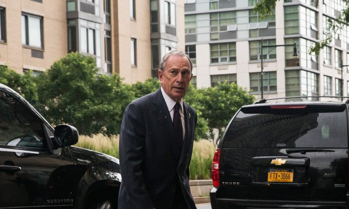 New York City Mayor Michael Bloomberg arrives at a press conference on June 13, 2013 in New York City. Bloomberg denied claims made in a June 17 Daily News article that the city's Department of Consumer Affairs (DCA) has a secret quota system used to pressure inspectors to issue fines. (Andrew Burton/Getty Images)