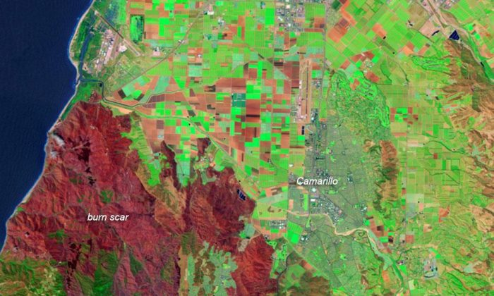 A NASA false-color satellite image shows the scar left by California wildfires early May 2013. Unburned vegetation appears dark green. Burned areas are red, and the most severely burned areas are generally the darkest. (NASA)