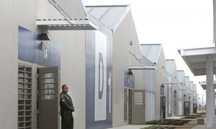 A correctional officer stands outside of one of the secure housing units at the new California Correctional Health Care Facility in Stockton, Calif., June 25, 2013. The facility, which is expected to begin receiving inmates in July, will treat up to 1,720 inmate-patients in need of long-term care, freeing up staff and treatment space at the state's 33 adult prisons. (AP Photo/Rich Pedroncelli)