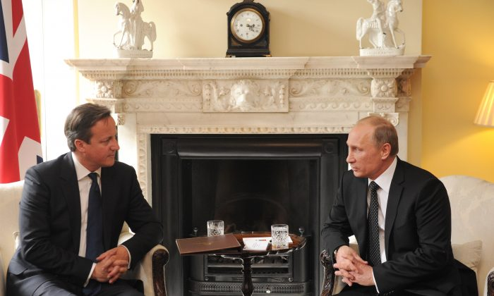 Britain's Prime Minister David Cameron (L) and Russian President Vladimir Putin (R) speak during a bilateral meeting at 10 Downing street in London, England, on June 16, 2013. Cameron meets with Russian President Putin for talks on the Syrian crisis amid fears that differences between Moscow and the West are pushing the two sides towards a new Cold War. (Anthony Devlin-Pool/Getty Images)