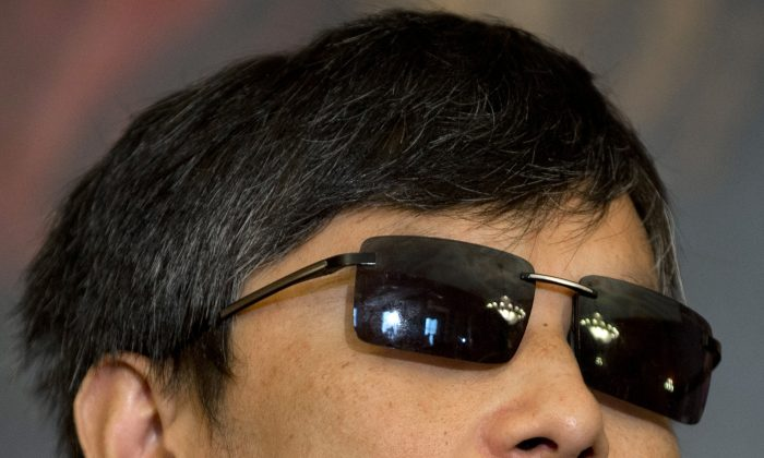 Chinese human rights activist Chen Guangcheng attends a press conference with Speaker of the House John Boehner and House Minority Leader Nancy Pelosi at the US Capitol in Washington, DC, August 1, 2012. (AFP/GettyImages/Saul Loeb)