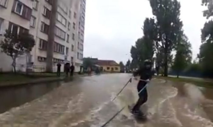 A wake boarder rips through the streets of Czech Republic during flooding in a video posted to YouTube June 2, 2013. (Screenshot/Youtube)