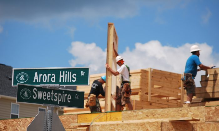 A construction team hard at work building homes in Clarksburg, Md. In a sign of economic rebound, construction continues in Clarksburg Village, on the subtle rolling hills of Maryland. (Ron Dory/Epoch Times)