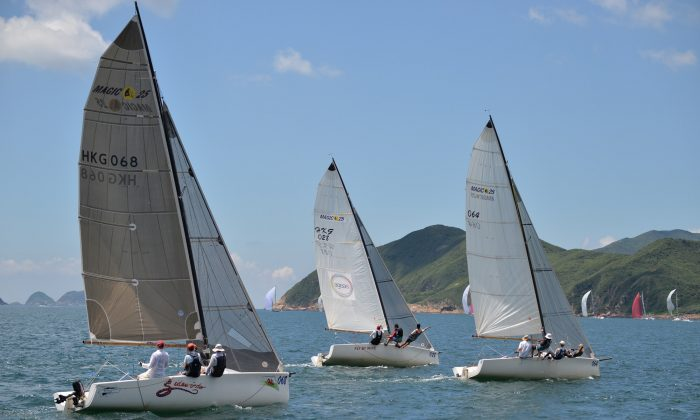 SMS Sports boats 'Merlin' (winner) leads 'Fly By Wire' (second place) and 'Side Winder' (fourth) after the start of Race-1 of the Hebe Haven Yacht Club Typhoon Series 2013 on Sunday June 2. (Bill Cox/The Epoch Times)