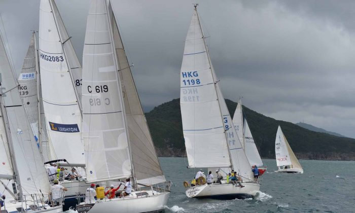 Competitive start ... HKPN boats prepare to start Race-2 of the Hebe Haven Typhoon Series on Sunday June 16, 2013. 'Scintilla' (sail No. 2083) won the race from 'Windseeker' (1198) and 'GA'. (Bill Cox/Epoch Times)