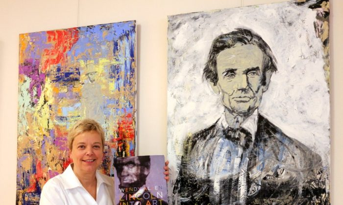 Wendy Allen standing with her paintings of Lincoln. Her new book is entitled LINCOLN IN ART. (Myriam Moran copyright 2013)