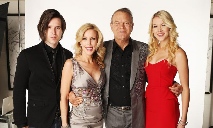 Cal Campbell, Kim Woolen, Glen Campbell, and Ashely Campbell pose in the Wonderwall.com Portrait Studio during 2012 CMT Music awards at the Bridgestone Arena in Nashville, Tenn., on June 6, 2012. (Christopher Polk/Getty Images for CMT)