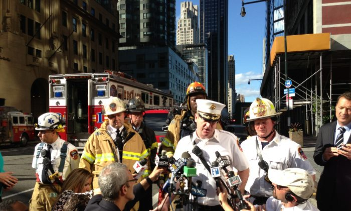 Deputy assistant chief James Leonard with the Fire Department of New York speak with the press following an FDNY rescue high atop the Hearst Tower in Midtown Manhattan on June 12. (Ivan Pentchoukov/The Epoch Times)