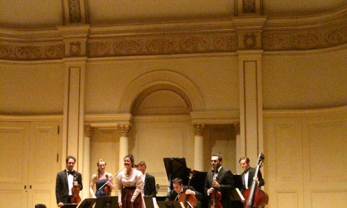 The Gustav Mahler String Quartet playing at Carnegie Hall on June 1. (L–R) Jesús Reina, Anna Margrethe Nilsen, Thérèse Mahler, Simon Reitmaier, Andrew Janss, Jesús Rodolfo Rodriguez, and Taddes Korris. (Amelia Pang/The Epoch Times)