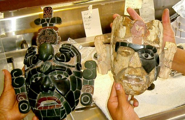 Pascual de Paz holds a replica of a Mayan tomb mask he is working on. Next to it is a finished model. (Courtesy of Myriam Moran)