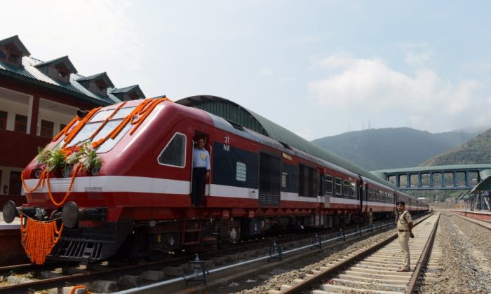 The train adorned with garlands ready for the flagging off ceremony by Indian Prime minister Manmohan Singh, some 110 km south of Srinagar, on June 26, 2013. Prime Minister flagged off a rail service, running between Banihal and Qazigund, in Kashmir during a rare trip, marred by a deadly militant-led ambush which killed eight soldiers, the service is second such rail project in divided Kashmir since 2008. (Tauseef Mustafa/AFP/Getty Images)