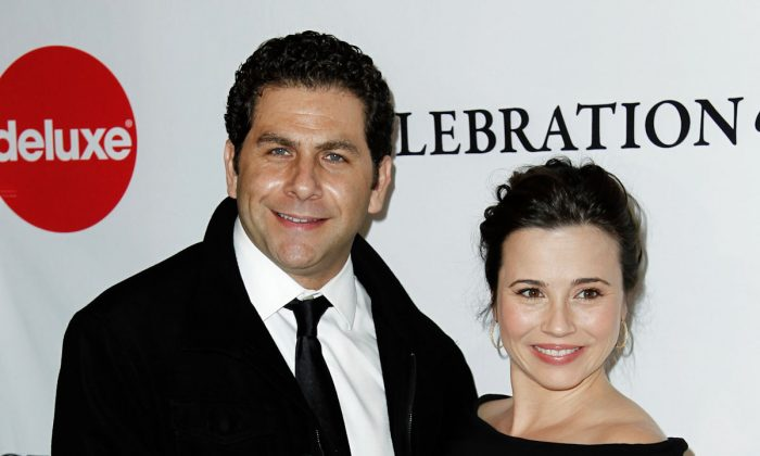 Actress Linda Cardellini (R) and Steven Rodriguez (L) arrive at the March of Dimes 6th Annual Celebration of Babies Luncheon in Beverly Hills, Calif., Friday, Dec. 2, 2011. The couple got engaged June 7, 2013. (AP Photo/Matt Sayles)