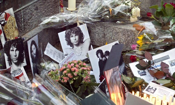 The grave of Jim Morrison, who died 42 years ago. His namesake, the giant lizard Barbaturex morrisoni, roamed the earth 40 million years ago. (JOEL ROBINE/AFP/Getty Images)