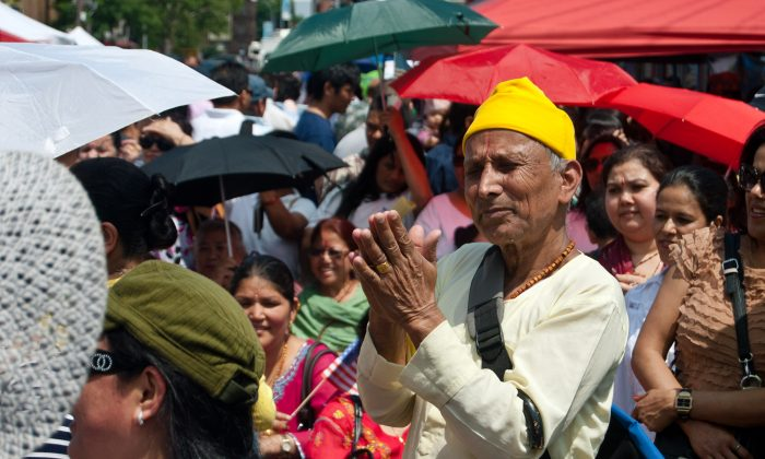 A man presses his palms together during the first Nepalese American Festival held in Jackson Heights in Queens, New York City on June 9. (Joshua Philipp/The Epoch Times)