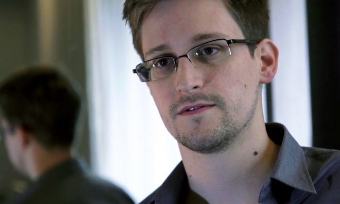 This photo provided by The Guardian Newspaper in London shows Edward Snowden, who worked as a contract employee at the National Security Agency, on Sunday, June 9, 2013, in Hong Kong. The Guardian identified Snowden as a source for its reports on intelligence programs after he asked the newspaper to do so on Sunday, which coincided with the end of the summit between Barack Obama and Xi Jinping. (AP Photo/The Guardian)