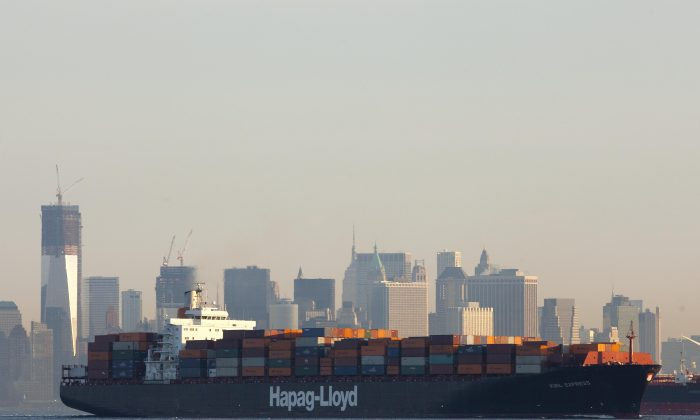 A file photo of a cargo ship crossing a New York Harbor on Feb. 4, 2012. Barriers in the export process may be stifling business in New York. (AP Photo/Mark Lennihan)