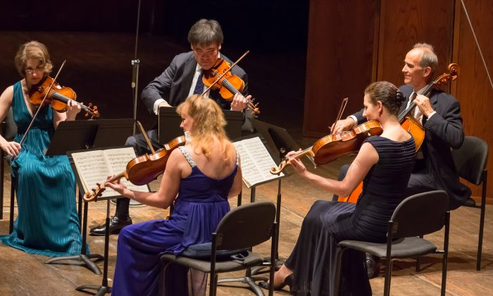 New York Philharmonic members (Clockwise from left) Sheryl Staples, Alan Gilbert, Carter Brey, Rebecca Young, and Cynthia Phelps, play the Brahms String Quintet No. 2 in G Major, Op. 111. at Avery Fisher Hall on June 8. (Courtesy of Chris Lee)