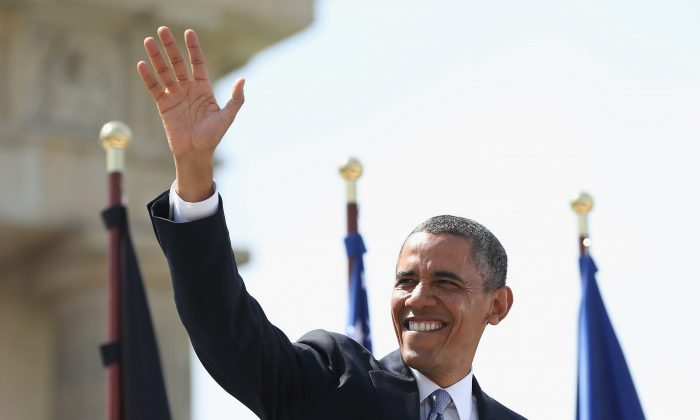 U.S. President Barack Obama waves as he arrives to speak at the Brandenburg Gate in Berlin, Germany, on June 19, 2013. Obama's speech focused on nuclear reductions and the role of the West in the Middle East. (Sean Gallup/Getty Images)