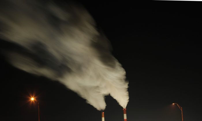 In this Jan. 19, 2012, file photo time exposure image smoke rises from the stacks of the La Cygne Generating Station coal-fired power plant in La Cygne, Kan. President Barack Obama says he'll unveil a national plan to combat climate change in a speech Tuesday, June 25, 2013. Obama says in an online video that he'll lay out his vision for reducing carbon pollution, preparing the U.S. for the effects of climate change and leading other nations in the global effort. (AP/Charlie Riedel)