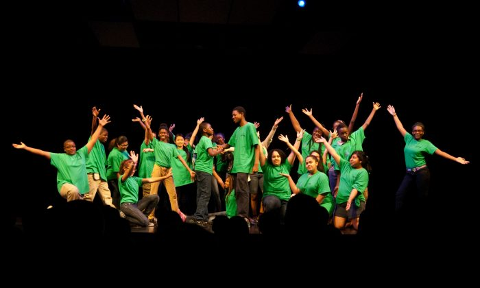 """Kids from several New York City schools pose at the end of the last performance in the 2013 Broadway Junior program. They performed """"To Life"""" from """"Fiddler on the Roof"""" on June 3 at the Broadhurst Theater in Manhattan. (Joshua Philipp/The Epoch Times)"""