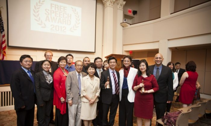 A group photo at the  45th World-Fest Houston Film Festival on April 23, 2012. From R to L: Film director Michael Perlman, Jennifer Zeng, Margaret Chew Barringer, Kean Wong, NTD President Zhong Lee, and Kean Wong's parents. On the far left is Charles Lee. Free China has recently opened for its theatrical release in the United States. (Edward Dai/The Epoch Times)