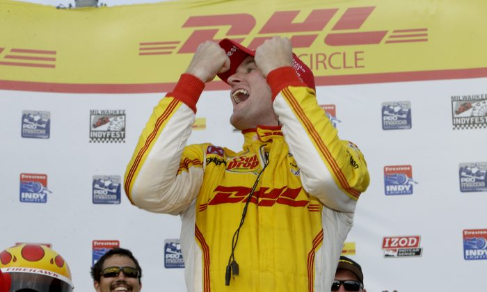 Ryan Hunter-Reay, driver of the #1 Andretti Autosport DHL Chevrolet roars in triumph after winning the Milwaukee IndyFest at the Milwaukee Mile on June 15, 2013 in West Allis, Wisconsin. (Mike McGinnis/Getty Images)