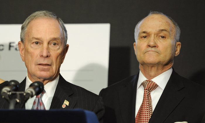 New York City Mayor Michael Bloomberg, left, speaks at a news conference as Police Commissioner Ray Kelly listens in Brooklyn, N.Y.  Dec. 29, 2011. Bloomberg responded June 13 to an 11th hour brief from the Justice Department supporting a federal monitor over the NYPD. (AP Photo/Mark Lennihan)