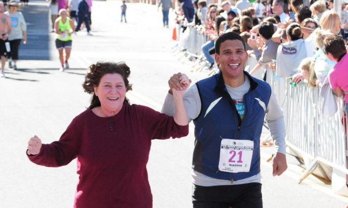 Robert Reffkin and his mother Ruth Reffkin at a marathon in New Mexico. He is running 50 marathons to raise $1 million for youth education nonprofits. (Courtesy of Robert Reffkin)