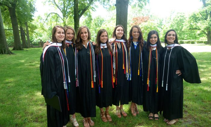 A group of 2013 Rhodes College graduates pose in Memphis, Tenn.  Congress is considering new rules for student loans, which are $1 trillion of consumer debt. (Mary Silver/Epoch Times)