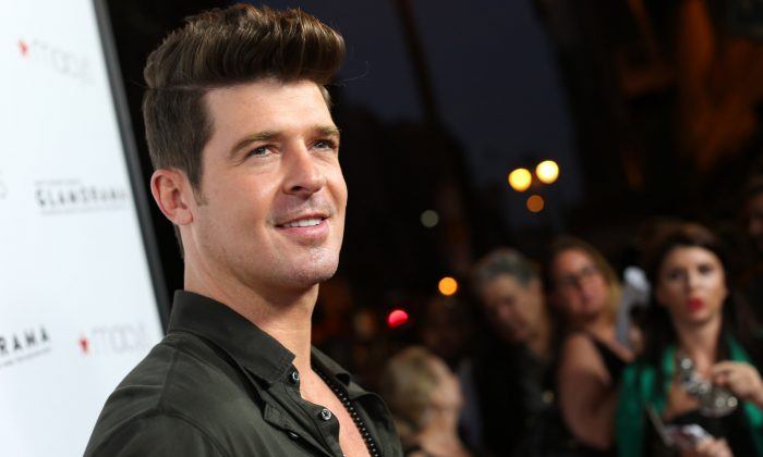 A file photo of singer Robin Thicke arriving at Macy's Passport Presents: Glamorama-30th Anniversary in Los Angeles held at The Orpheum Theatre on Sept. 7, 2012. (Christopher Polk/Getty Images)