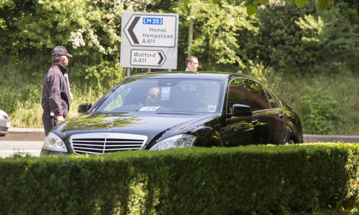 Restricted access for the press at the clandestine Bilderberg gathering 2013 at The Grove Hotel in Watford. They have constructed a wall around the venue and kept the press about a mile away. (Si Gross/Ben Dome )