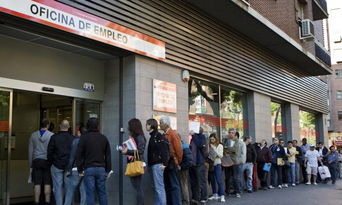 People wait in line at a government employment office in Madrid on June 4, 2013. (Sebastien Berda/AFP/Getty Images)