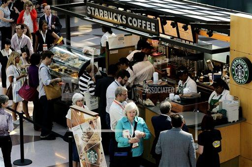 In this Thursday, May 30, 2013, file photo, customers line up at a Starbucks Coffee in New York. Starbucks baristas must share their tips with shift supervisors, New York's highest court ruled June 26, 2013 (AP Photo/Mark Lennihan)