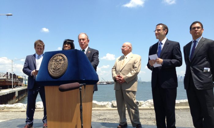 Mayor Michael Bloomberg speaks at the groundbreaking ceremony of the New Stapleton Development Plan on June 20, 2013. Behind him, looking on, (L-R) are David Barry, President of Ironstate Development, New York City Councilwoman Debi Rose, borough president of Staten Island James P. Molinaro, and president of the New York City Economic Development Corporation Seth Pinsky. (Ivan Pentchoukov/Epoch Times)