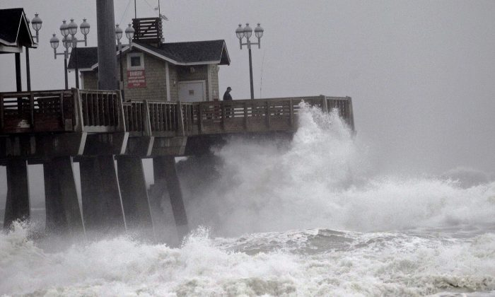 Large waves generated by Hurricane Sandy crash into Jeanette's Pier in Nags Head, N.C., on Oct. 27, 2012. (Gerry Broome/AP Photo)