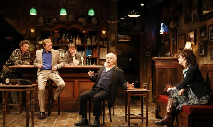 "(L–R) John Keating (Jim), Sean Gormley (Finbar), Billy Carter (Brendan), Dan Butler (Jack), and Tessa Klein (Valerie) in Conor McPherson's ""The Weir."" (Carol Rosegg)"