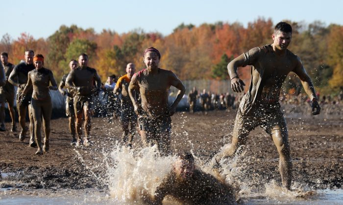 Participants compete in the Tough Mudder event at Raceway Park on October 21, 2012 in Englishtown, New Jersey. (Photo by Bruce Bennett/Getty Images)