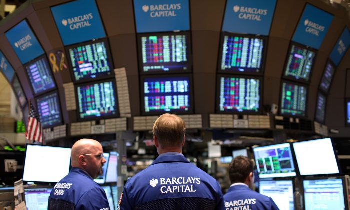 Traders work on the floor of the New York Stock Exchange moments before the closing bell. (Spencer Platt/Getty Images)