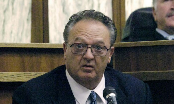 In this Sept. 17, 2008 file photo, John Martorano is questioned about his plea agreement in exchange for testifying against former FBI agent John Connolly, in the Miami Courthouse.  (AP Photo/Marice Cohn Band, Pool, File)