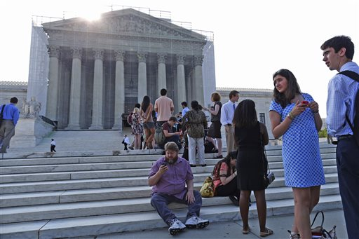 People line up in front of the Supreme Court in Washington, Monday, June 24, 2013, before it opens. The Supreme Court has 11 cases, including the term's highest profile matters, to resolve before the justices take off for summer vacations, teaching assignments and international travel. The Supreme Court has 11 cases, including the term's highest profile matters, to resolve before the justices take off for summer vacations, teaching assignments and international travel. (AP Photo/Charles Dharapak)